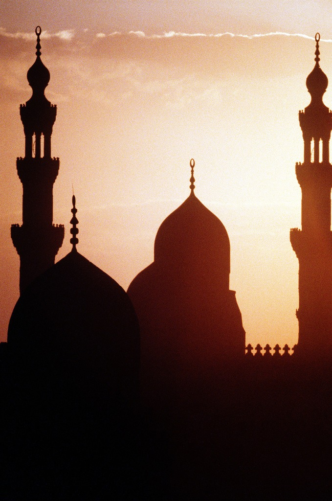 Sunset view of Cairo, Egypt skyline showing minarets and temple spires. Exact Date Shot Unknown